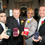 Grooms showing their ring boxes w/ rings Rick, David, Ryan and John.
