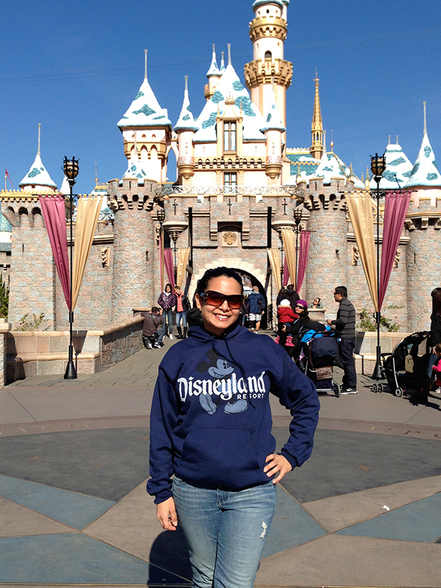 Chief Editor Niloufar Gibson is a huge Disneyland fan! Here she is taking a photo in front of Cinderella's Castle, an amazing spot to propose!